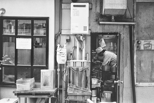Chef working in a tiny kitchen in Tokyo, Japan.